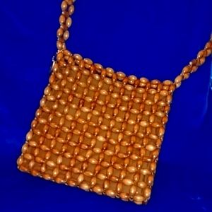 American Outfitter Wooden Bead Bag